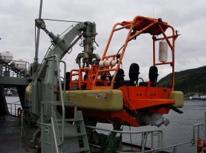 This small boat is used for rescue operations (such as a man overboard).